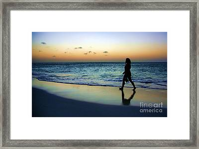 Framed Print featuring the photograph Sunset Stroll In Aruba by Polly Peacock