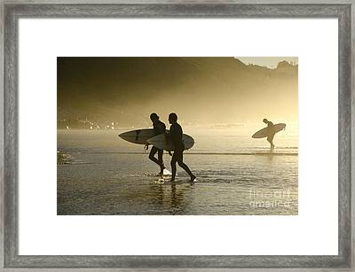 Sunset Surfers Biarritz Framed Print by Perry Van Munster
