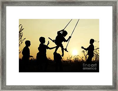 Sunset Swing Framed Print by Tim Gainey