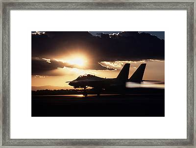 Sunset Take Off Framed Print by Peter Chilelli