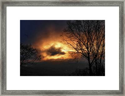 Sunset Through Stormy Clouds Framed Print