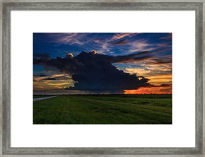 Sunset Through The Rain Framed Print