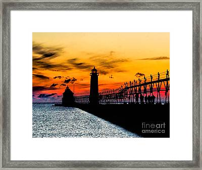 Sunset Walking On Grand Haven Pier Framed Print by Nick Zelinsky