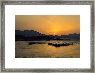 Sunset With Facility For Fishing Anchovy By Flow Of Sea Water Framed Print