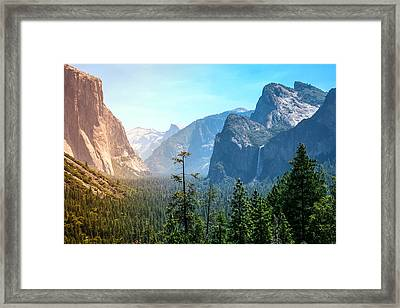 Sunset's Golden Light Moves Across Yosemite Valley's Waterfalls Framed Print by Laura Palmer