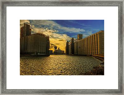 Sunsets On A River Through An Industrial Canyon Framed Print