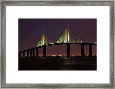 Sunshine Skyway At Dusk Framed Print by Daniel Woodrum