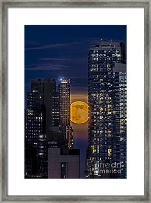 Super Moon Rises Over The Big Apple Framed Print by Susan Candelario