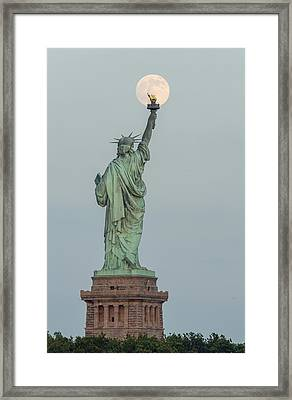 Super Moon Rises Over The Statue Of Liberty Framed Print