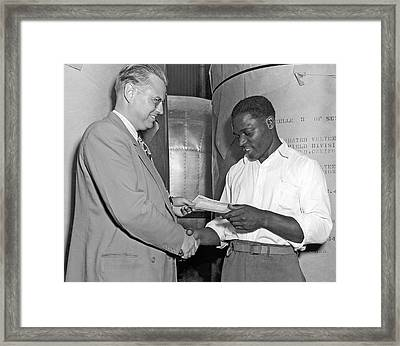 Supervisor Rewards Worker Framed Print by Underwood Archives