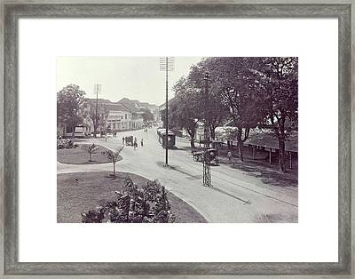Surabaya With Trams, Trolleys And Passersby Framed Print
