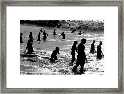 Surf Swimmers Framed Print by Sean Davey
