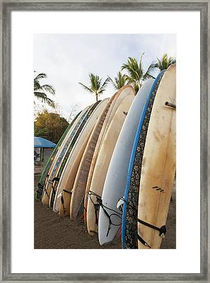 Surfboards Standing Up Against A Rack Framed Print by Keith Levit