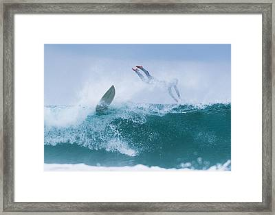 Surfer Diving Into Water Framed Print