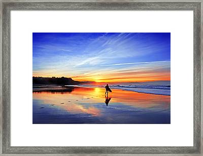 Surfer In Beach At Sunset Framed Print by Mikel Martinez de Osaba