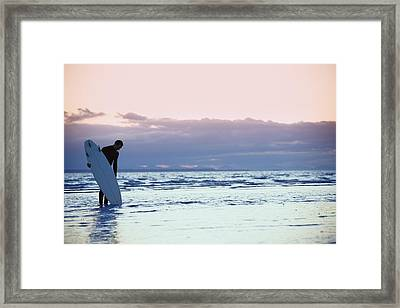 Surfer In The Shallow Water Framed Print by Daniel Sicolo
