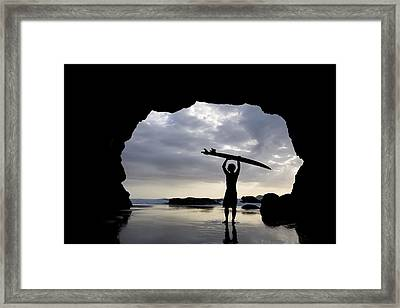 Surfer Inside A Cave At Muriwai North Framed Print by Deddeda
