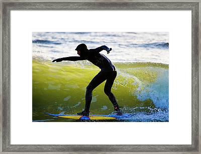 Surfer Riding A Wave Framed Print by Linda Wright