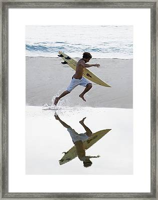 Surfer Running With Surfboard Framed Print by Ben Welsh