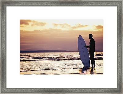 Surfer Silhouette Framed Print by Daniel Sicolo