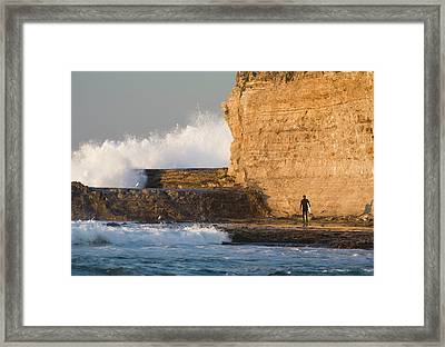 Surfer Sizing Up The Challenge Framed Print by Tom Norring