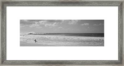 Surfer Standing On The Beach, North Framed Print by Panoramic Images