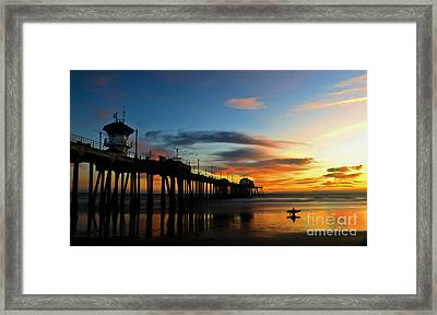 Surfer Watching The Sunset Framed Print by Peter Dang