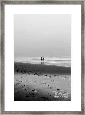 Surfers In The Mist Framed Print by Terri Waters