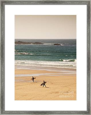 Surfers On Beach 01 Framed Print by Pixel Chimp
