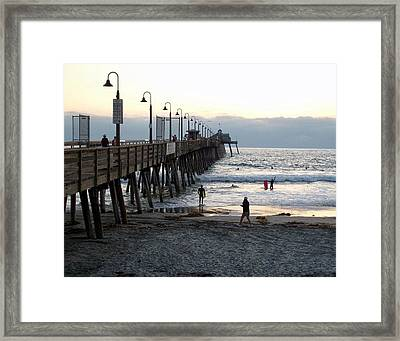 Surfing At Dusk Framed Print