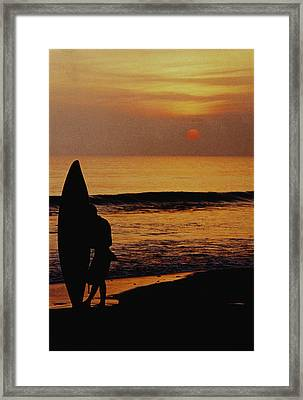 Surfing At Sunset Framed Print by Anonymous