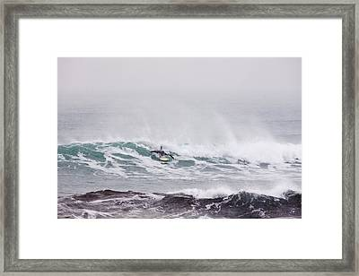 Surfing In The Snow Framed Print by Tim Grams