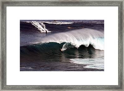 Surfing Jaws Maui  Framed Print by Paul Karanik
