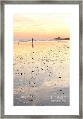 Surfing Sunset Framed Print by Eric  Schiabor