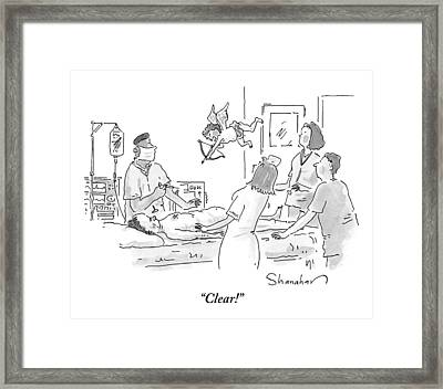Surgeon And Nurses In An Operating Room Framed Print