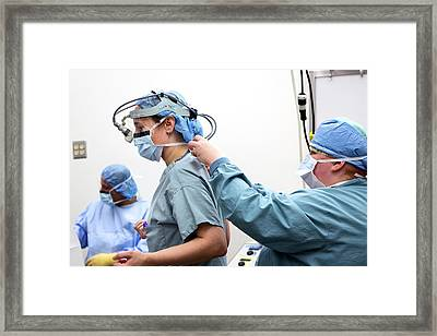 Surgeon Preparing For Surgery Framed Print by Jim West
