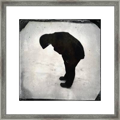 Surreal Silhouette Of A Person In The Snow Framed Print by Matthias Hauser