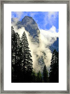 Surrounded By Clouds Framed Print
