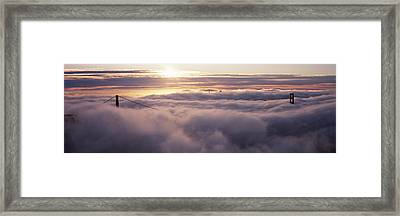 Suspension Bridge Covered With Fog Framed Print by Panoramic Images