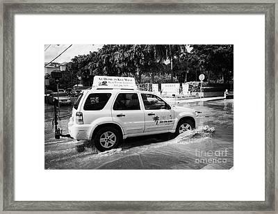 Suv Driving Through Streets Flooded By Heavy Rainfall Key West Florida Usa Framed Print by Joe Fox