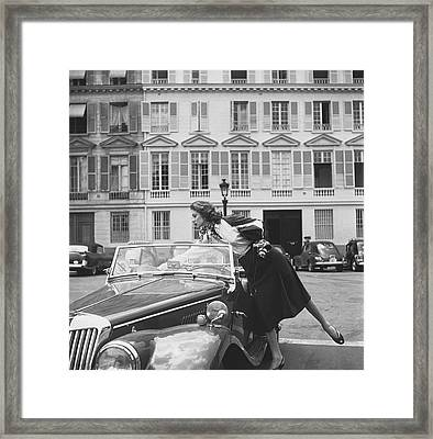 Suzy Parker Outside The French Vogue Office Framed Print by Jacques Boucher