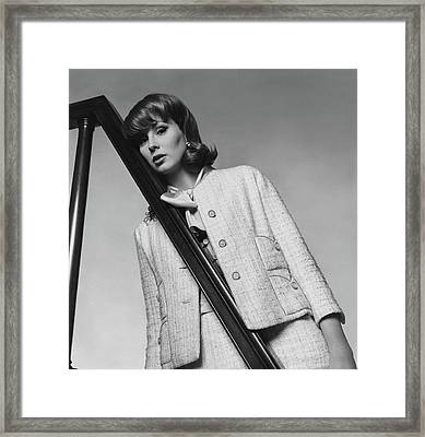Suzy Parker Wearing A Chanel Suit Framed Print by Horst P. Horst