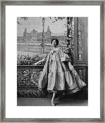 Suzy Parker Wearing A Coat By Pertegaz Framed Print by Henry Clarke