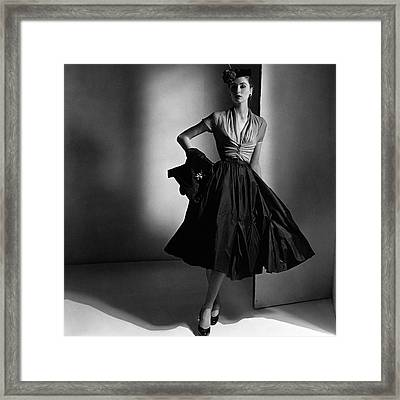 Suzy Parker Wearing A Dior Dress And Jacket Framed Print by Horst P. Horst