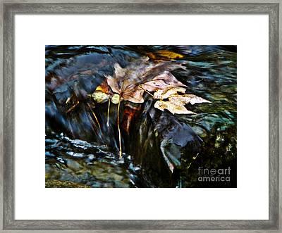 Swept Away Framed Print by Chris Sotiriadis