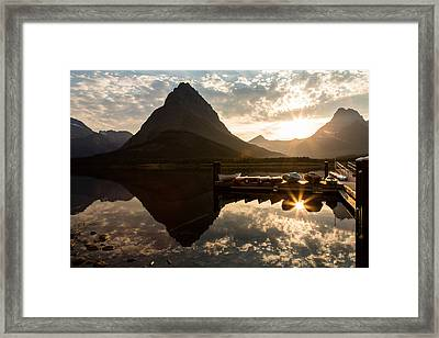 Swiftcurrent Lake Boats Reflection And Flare Framed Print by John Daly