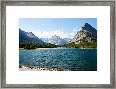 Swiftcurrent Lake Framed Print by John M Bailey