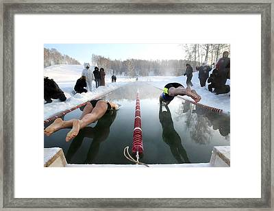 Swimmers Diving Into Ice-covered Pool Framed Print by Science Photo Library