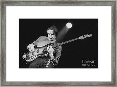 Swingin Above The Moon Framed Print by Philippe Taka