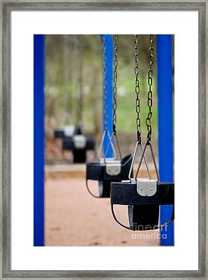 Swings In A Row Shallow Dof Framed Print